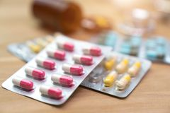 Packaging of tablets and pills on the table. Medicine Stock Photography