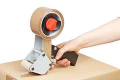 Free Packaging Tape Dispenser And Shipping Box Stock Photography - 14045062