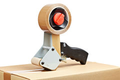 Free Packaging Tape Dispenser And Shipping Box Stock Photos - 16483493