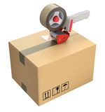 Packaging tape dispenser and cardboard box Stock Image