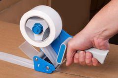 Packaging tape dispenser. Cardboard boxes stick dispenser for adhesive tape royalty free stock photography