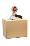 Packaging tape dispenser and shipping box Royalty Free Stock Image