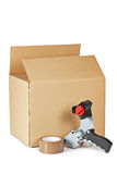 Packaging tape dispenser and shipping box stock photography