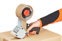 Packaging tape dispenser and shipping box Royalty Free Stock Photography
