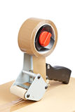 Packaging tape dispenser and shipping box Stock Image