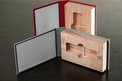Packaging for USB drives. Handmade box. Wooden boxes on dark background Royalty Free Stock Photos