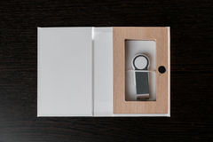 Packaging for USB drives. Handmade box. Wooden boxes on dark background Royalty Free Stock Image