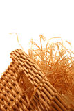 Basket with wood wool. Basket filled with shredded wood excelsior isolated on white background Royalty Free Stock Image