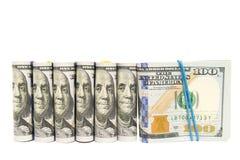 Packar av hundra grupperade dollarräkningar, isolerad copyspace Royaltyfria Bilder