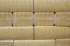 packar neatly staplad sawdust royaltyfria foton