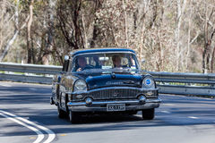 1952 Packard 200 Deluxe sedan. Adelaide, Australia - September 25, 2016: Vintage 1952 Packard 200 Deluxe sedan driving on country roads near the town of Birdwood Royalty Free Stock Photos