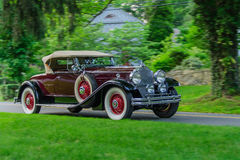 Packard Roadster (1930). Restored 1930 Packard Roadster motors along narrow New England road after Tuesday night auto show in Essex, CT Stock Photography