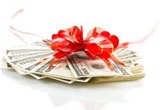 Packe av dollar och det röda bandet Fotografering för Bildbyråer