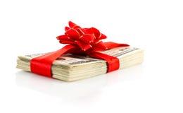 Packe av dollar och det röda bandet Royaltyfri Foto