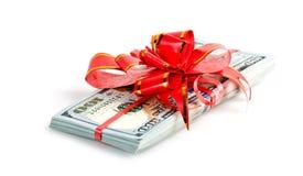 Packe av dollar och det röda bandet Royaltyfri Fotografi
