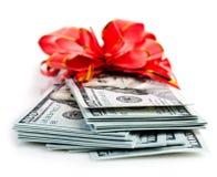 Packe av dollar och det röda bandet Arkivfoto