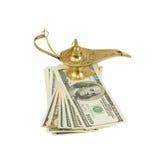 Packe av dollar och magisk lampa av Aladdin Arkivbild