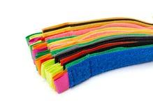 Packe av färgrika velcroremsor Arkivbild