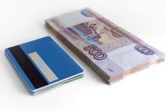 Packe av pengar och packe av kortet Royaltyfri Bild