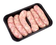 Packe av rå grisköttkorvar Fotografering för Bildbyråer