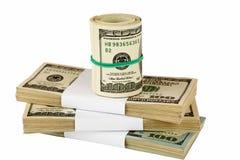 Packe av US dollar som staplas på de Arkivbilder