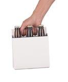 packe sex för ölflaskahandholding Royaltyfria Foton