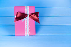 Packed box, gift on a wooden light-blue background. Selective focus, toned image, film effect.  Royalty Free Stock Image
