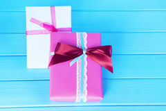 Packed boxes, gifts on a wooden light-blue background. Selective focus, toned image, film effect.  Stock Photography