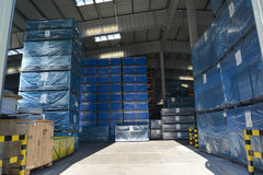 The packed boxes in a modern factory warehouse. Cargo Royalty Free Stock Photo