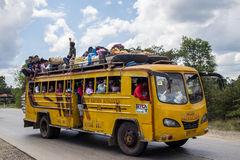 Packed bus in the Philippines. With luggage on the roof and people sitting on the roof Stock Photos