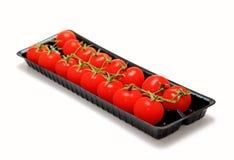 Packed cherry tomatoes. Cherry tomatoes packed in a box Stock Image