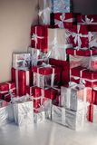 Packed Christmas gifts stacked in the corner. stock photo