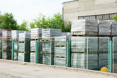Packed cinder blocks outdoors in racks Royalty Free Stock Photos