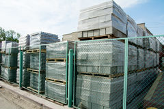 Packed cinder blocks outdoors in racks. Royalty Free Stock Photography