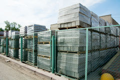 Packed cinder blocks outdoors in racks. Royalty Free Stock Image
