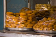 Packed doughnuts in heaps for sale Stock Photo