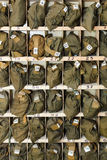 Packed gas-masks in cells Stock Photo