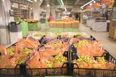 Packed green grapes in the boxes in the supermarket. stock photography