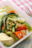 Packed meal with healthy vegetables. Takeout meal with healthy vegetable variety. Suitable for concepts such as diet and nutrition, healthy lifestyle, and food Royalty Free Stock Image