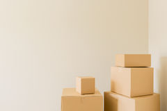 Packed Moving Boxes In Empty Room Stock Photography
