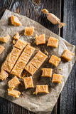 Packed in paper sweet caramel candies with sesame Stock Photography