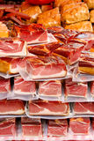 Packed pieces of meat on a market Stock Images