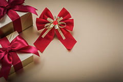 Packed present boxes with tied ribbons red bow Royalty Free Stock Photography