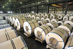 Packed rolls of steel sheet. Inside of plant Stock Image