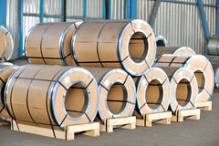 Packed rolls of steel sheet. In warehouse Stock Images