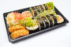 Packed salmon sushi. Tasty fresh japanese sushi with tuna and shrimp Royalty Free Stock Photos