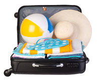 Packed suitcase full of vacation items Stock Images