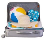 Packed suitcase full of vacation items Royalty Free Stock Photos