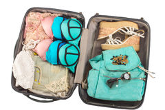 Packed suitcase full of vacation items. Stock Photo