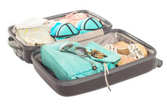 Packed suitcase full of vacation items. Royalty Free Stock Photo